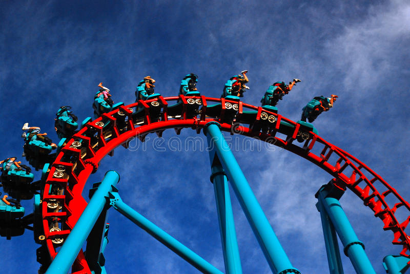 Inversion. Thrill rides take their fans for an upside down ride royalty free stock photos