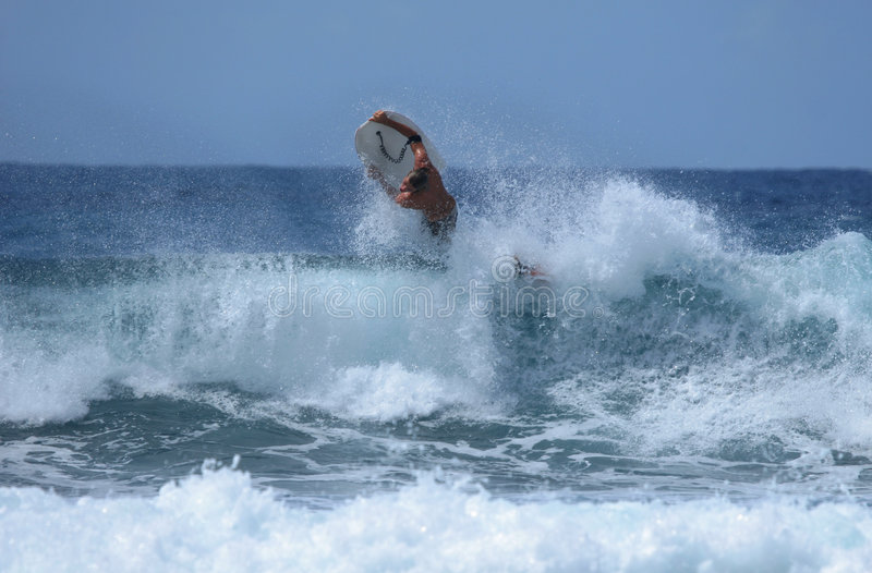Invert air. Bodyboarder does an inverted air on a big wave stock photos