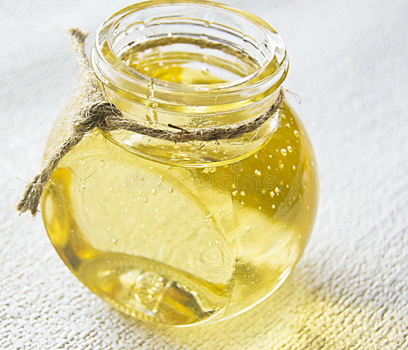 Invert syrup. In a glass container, honey in a glass jar stock photography