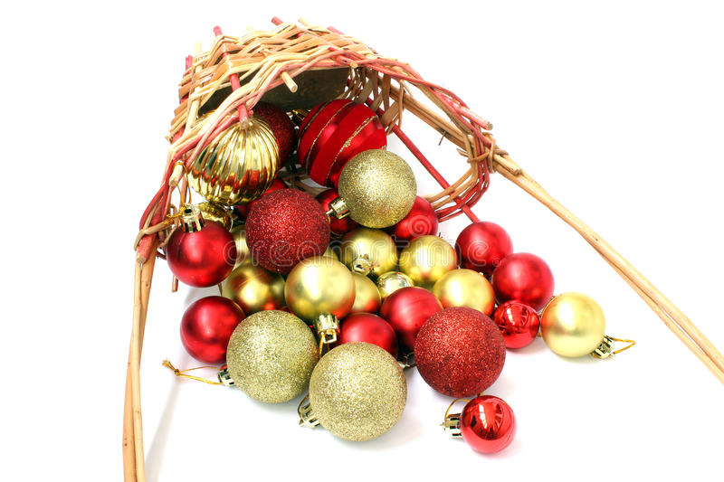 Inverted basket of Christmas balls. Inverted basket of Christmas red and gold balls royalty free stock image