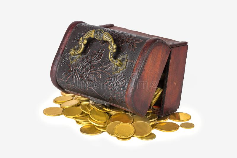 Pirate chest with scattered golden coins on a white background isolate royalty free stock photo