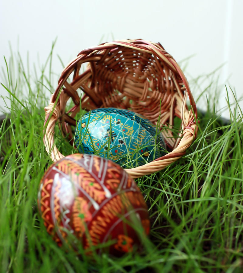 Inverted easter basket with eggs. On a grass royalty free stock image