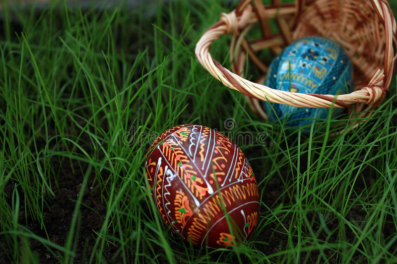 Inverted easter basket with eggs. On a grass stock image