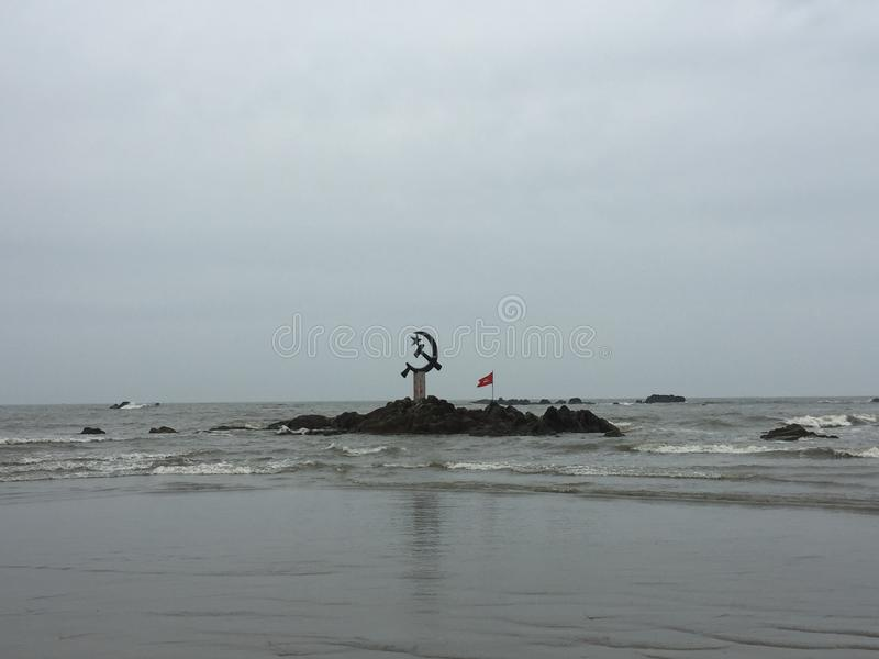 The inverted hammer and sickle symbol of Communism off the coast of Kunoor. stock photo
