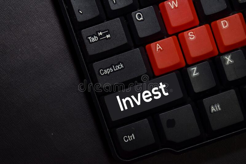 Invest isolated on laptop keyboard background stock image