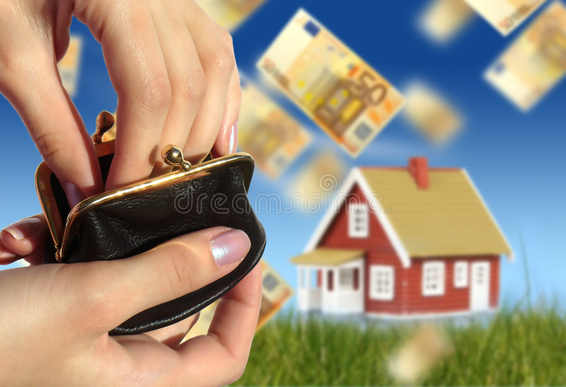 Invest in real estate. Concept of home ownership. Hands with black purse. New house on the background royalty free stock photo