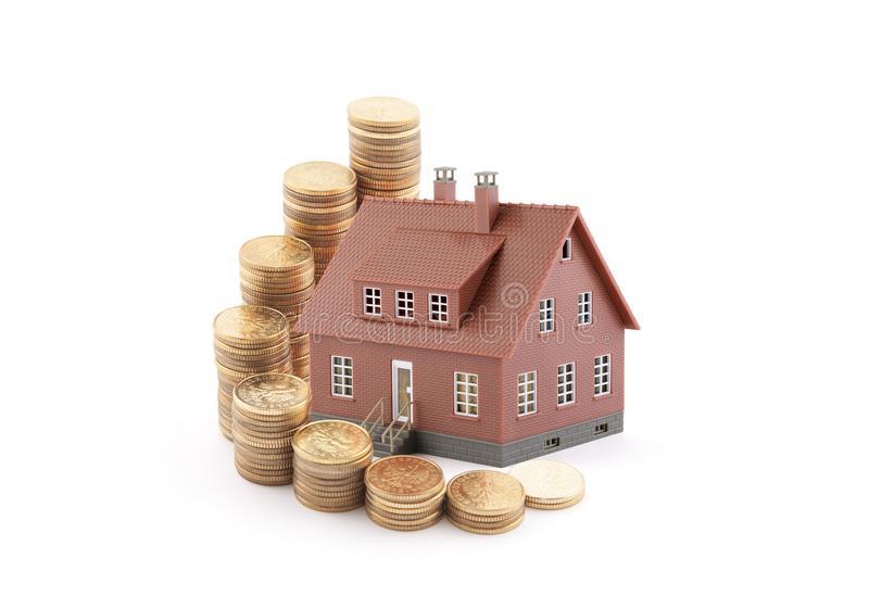 Invest in real estate concept. Small brown house with golden coins. Invest in real estate concept. Small brown toy house with golden coins stock photo