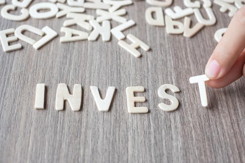INVEST word of wooden alphabet letters. Business and Idea. Concept royalty free stock image