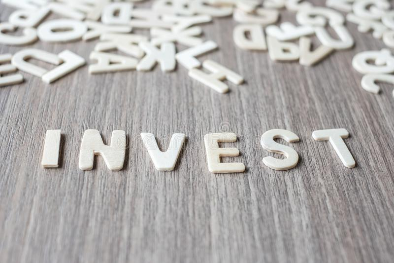 INVEST word of wooden alphabet letters. Business and Idea. Concept stock photography