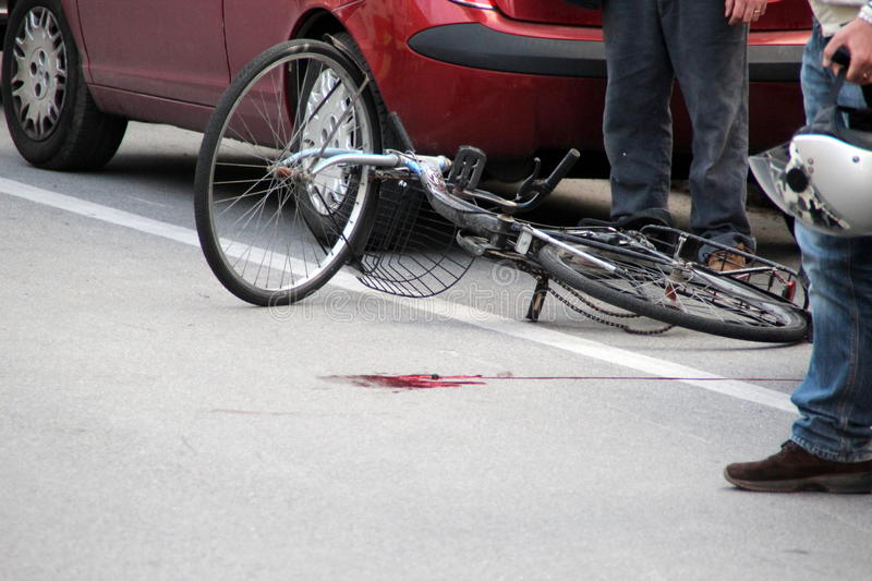Invested cyclist accident stock photo