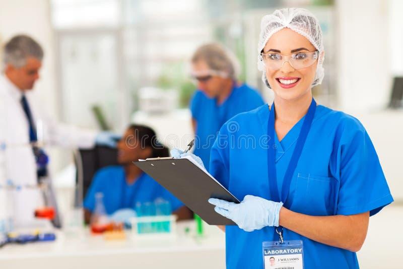 Investigador médico de sexo femenino fotos de archivo