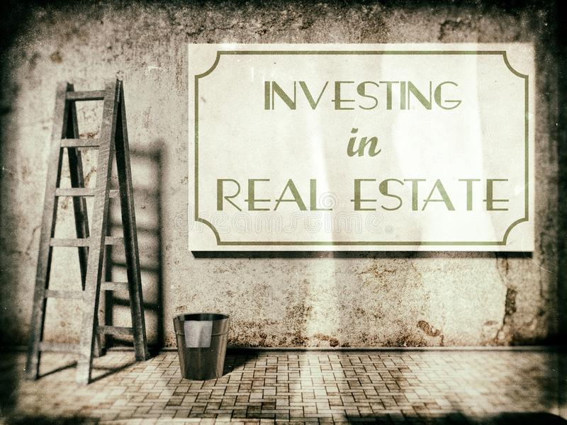 Investimento em bens imobiliários na parede foto de stock royalty free