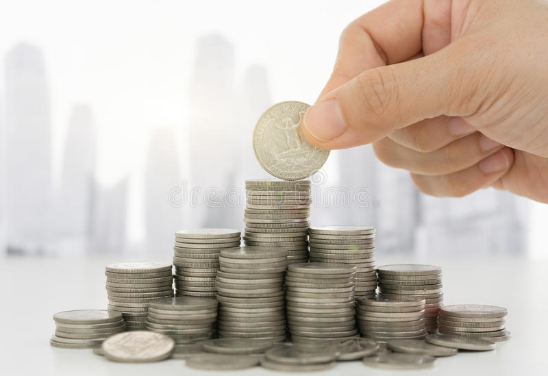 Investing. Business people putting coin on stack of coins with city background. Concepts of finance, investing, investment, invest, savings royalty free stock photos