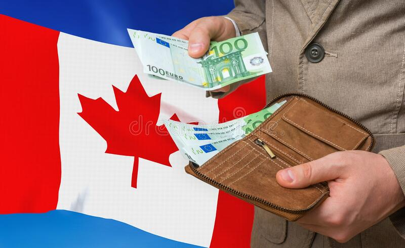 Investing money to Canada. Rich man with a lot of money royalty free stock photo