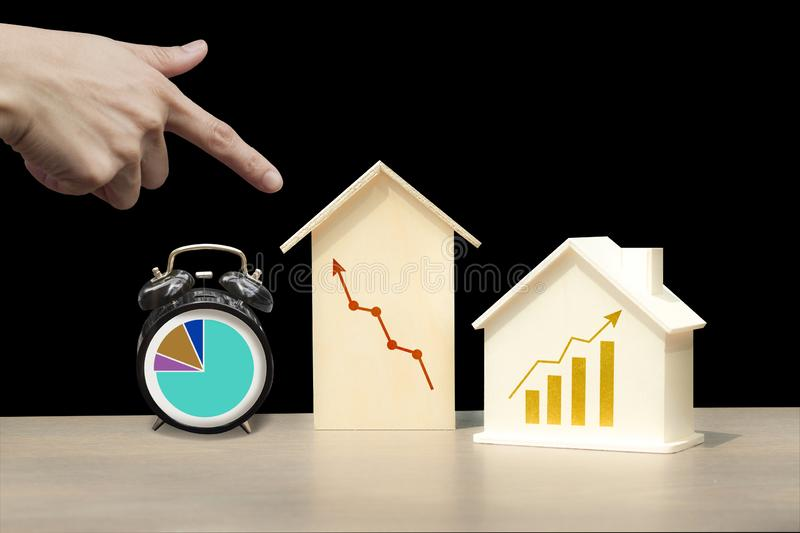 Investing in properties that have good returns in a short period of time. Houses, buildings and clocks in the picture have a graph line up. Represents investment stock images