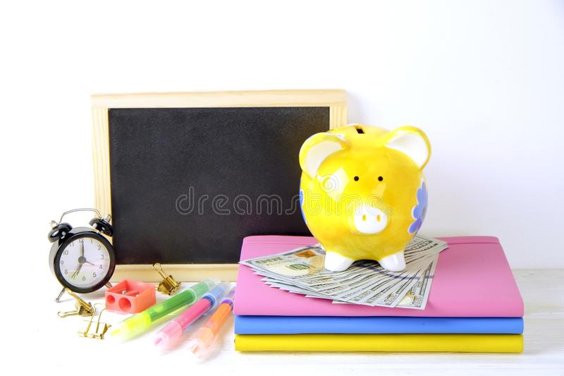 Investing time and money into education concept. Different school supplies, banknotes. Top view, close up. stock photo
