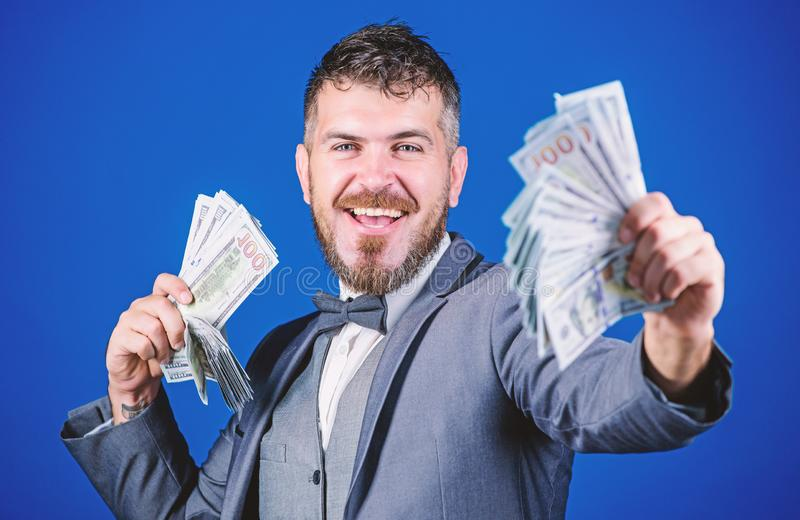 Investing to become rich. Business startup loan. Bearded man holding cash money. Making money with his own business. Currency broker with bundle of money. Rich stock image