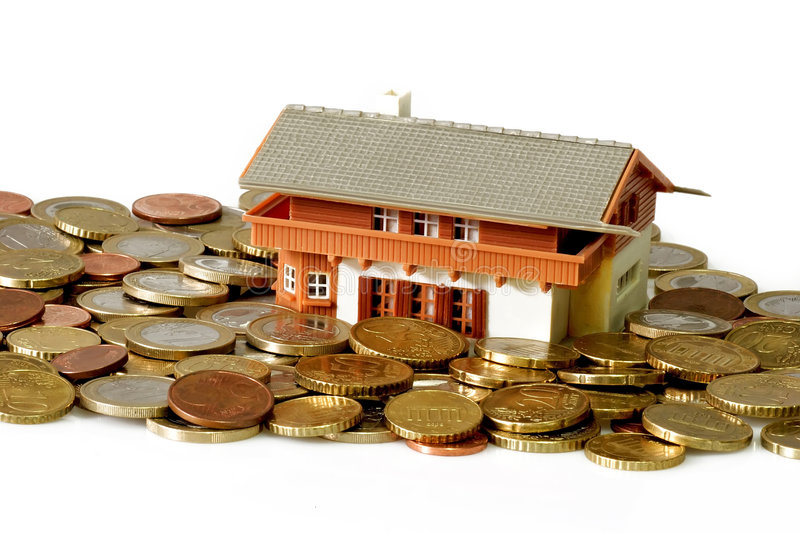 Investment. Toy house with euro coins on bright background royalty free stock images