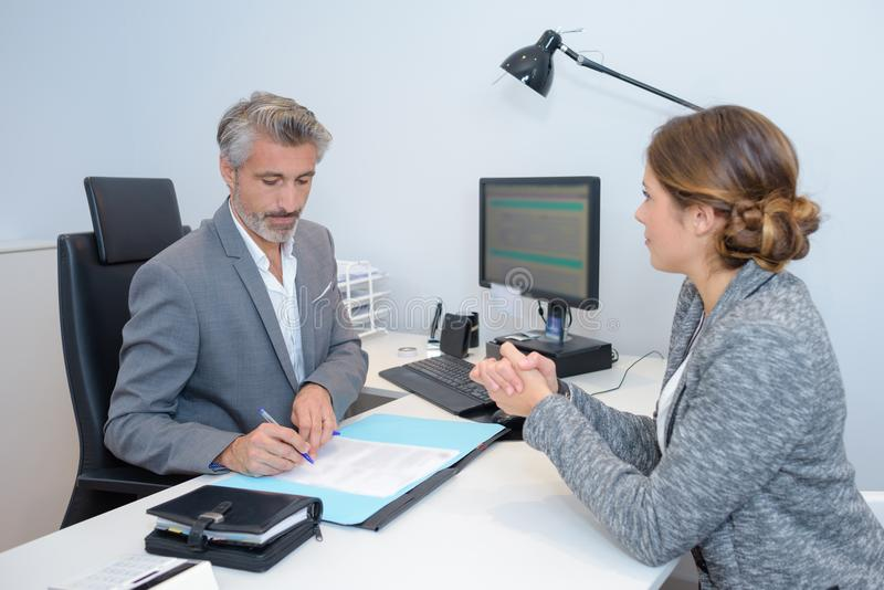 Investment advisor with female customer royalty free stock photography