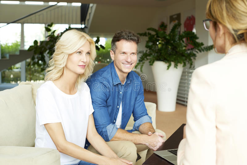Investment advisor and her clients royalty free stock image