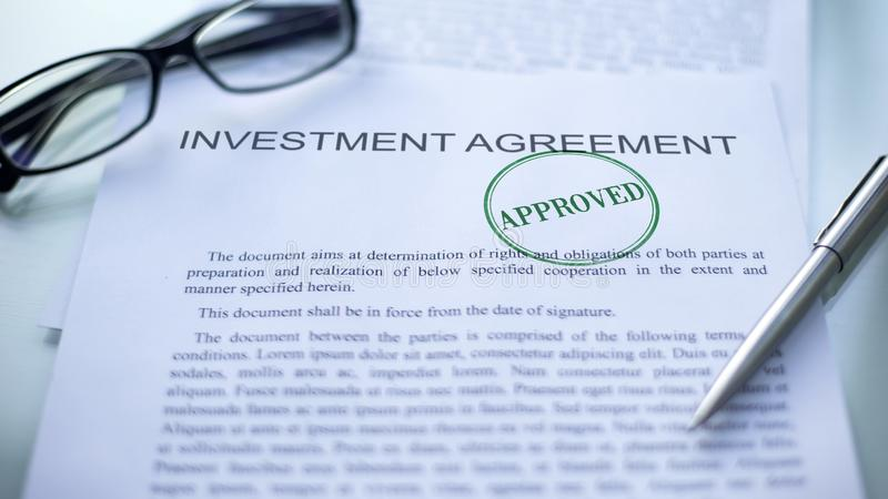 Investment agreement approved, seal stamped on official document, business. Stock photo stock photos