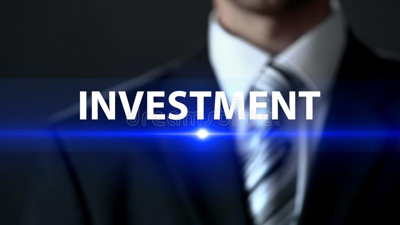 Investment, businessman wearing suit standing in front of screen, future profit. Stock photo royalty free stock photos
