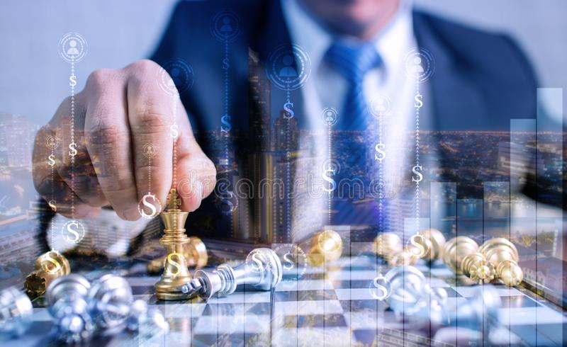 investment concept of business man  planning and putting  chess of finance money on board royalty free stock images