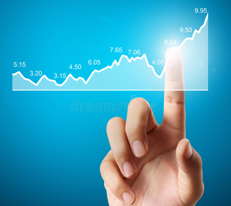 Investment concept with financial chart symbols coming from hand royalty free stock images