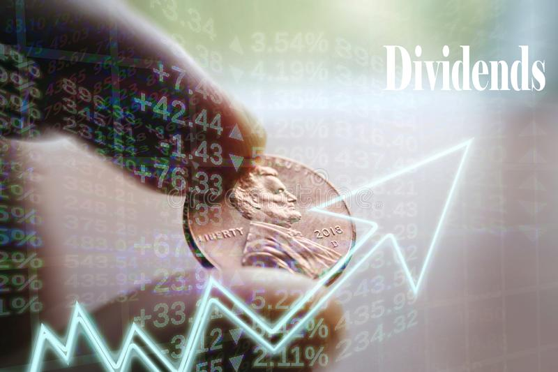 Investment Dividend Concept With Penny In Hand High Quality. Stock Photo royalty free stock images