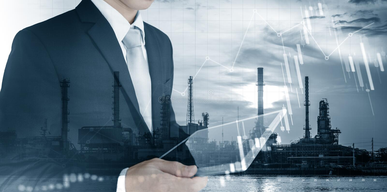 Investment in energy and fuel business. Double exposure Businessman working on digital tablet with power plant, oil refinery and r royalty free stock photo
