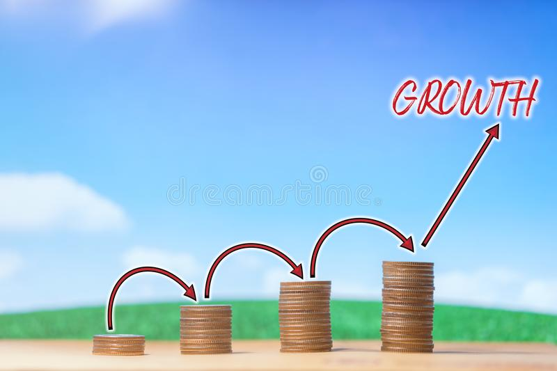 Investment, financial, business concept. Money of coin stack with arrow step up growing growth on blue sky and white cloud. Several piles of coins as symbol of stock photos