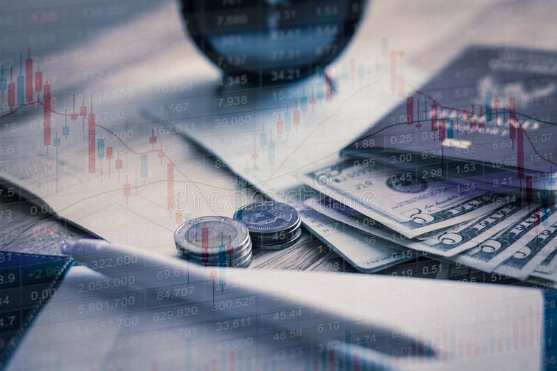 Investment with little budget and document on the table. Investment with little budget and document on the table, Stock market graph infomation royalty free stock photo