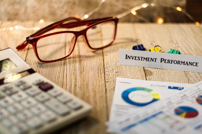Investment Performance concept with charts and graphs on wooden board. Investment Strategy motivational finance budget concept with charts and graphs and stock photography