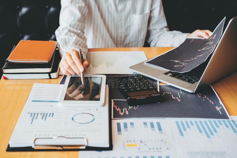 Investment stock market Entrepreneur Business Man discussing and analysis graph stock market trading,stock chart.  stock photos