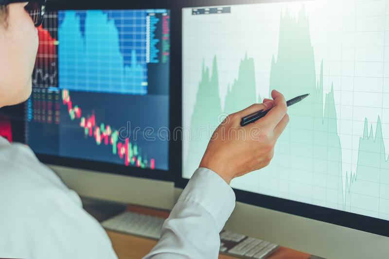 Investment stock market Entrepreneur Business Man discussing and analysis graph stock market trading,stock chart concept.  royalty free stock photography