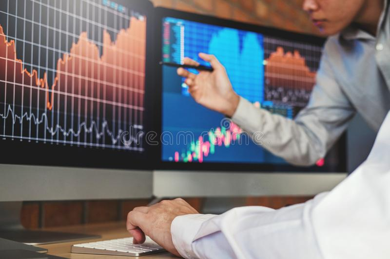 Investment stock market Entrepreneur Business Team discussing and analysis graph stock market trading,stock chart concept royalty free stock photos