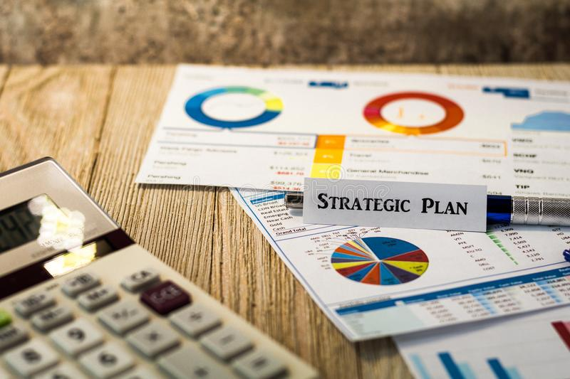 Strategic Plan Investment business finance concept with charts and graphs on wooden board. Investment Strategy motivational finance budget concept with charts stock photo