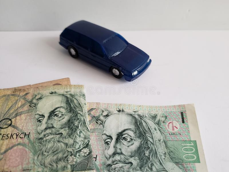 czech banknotes and figure of a car in dark blue royalty free stock images