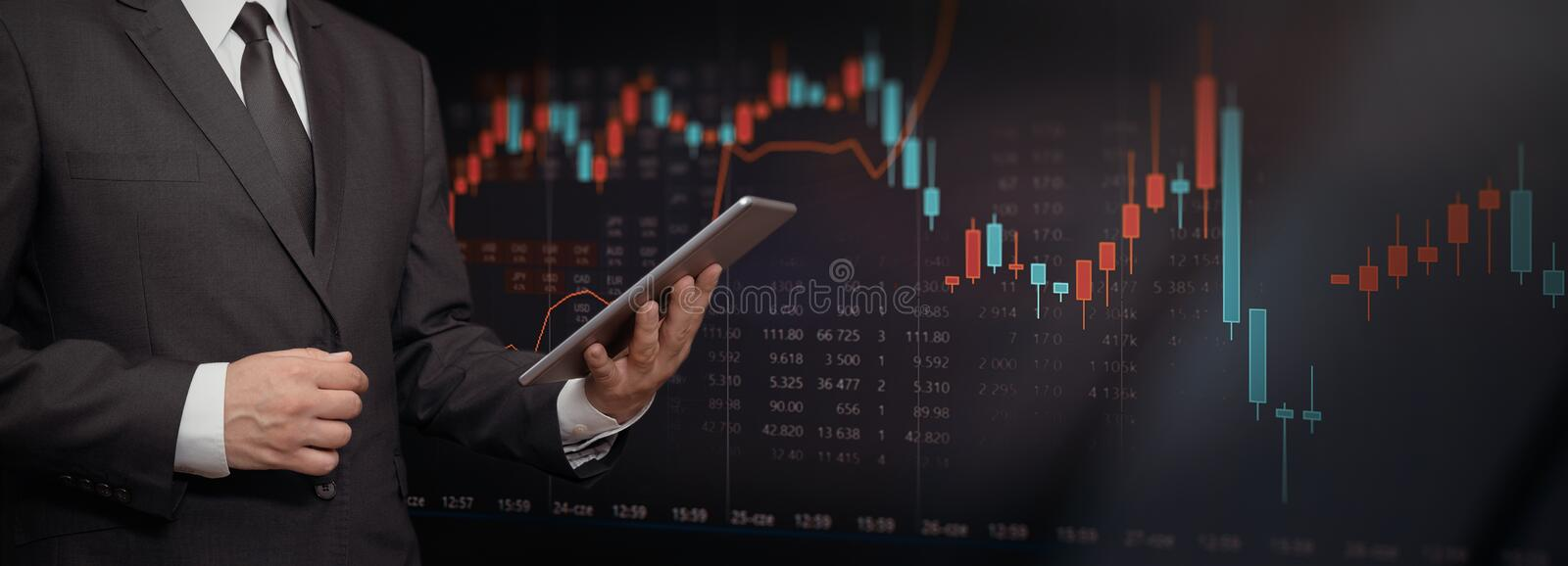 Investor with tablet, stock market background stock photos