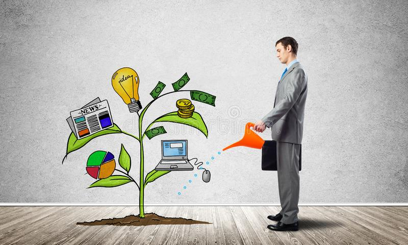 Investor watering drawing tree with symbols. Investor watering drawing green sprout consisted of infographic symbols. Professional consultation and assistance royalty free stock photo