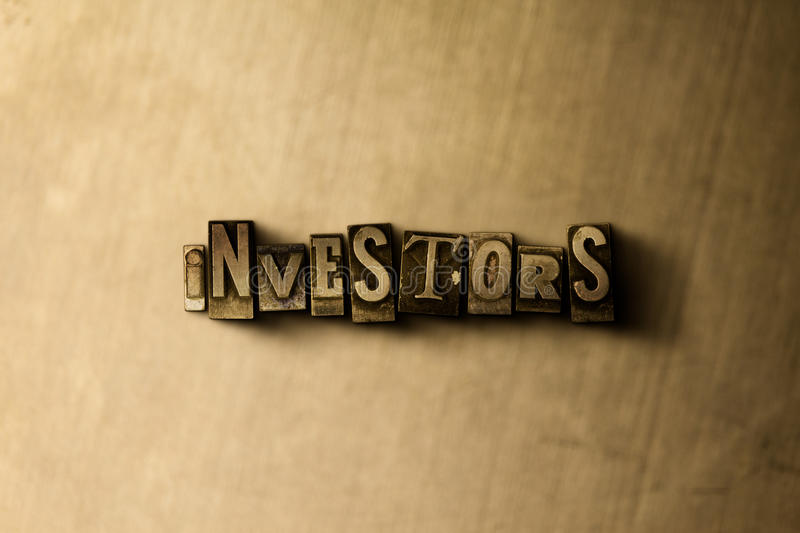 INVESTORS - close-up of grungy vintage typeset word on metal backdrop stock photos