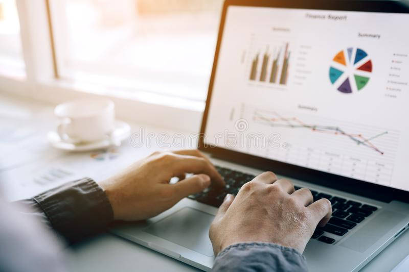 Investors are using laptop computers to analyze graphs in the morning.  stock images