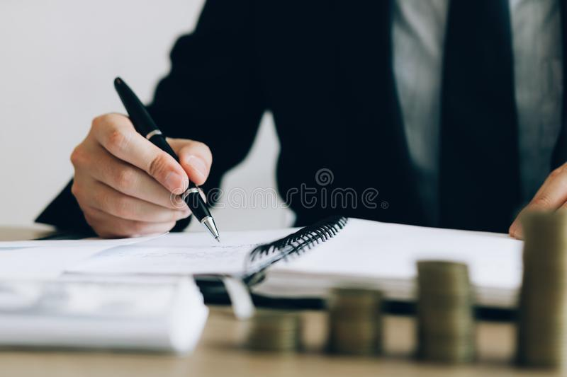 Investors are writing investment records and growth of mutual funds on the table at the office.  stock image