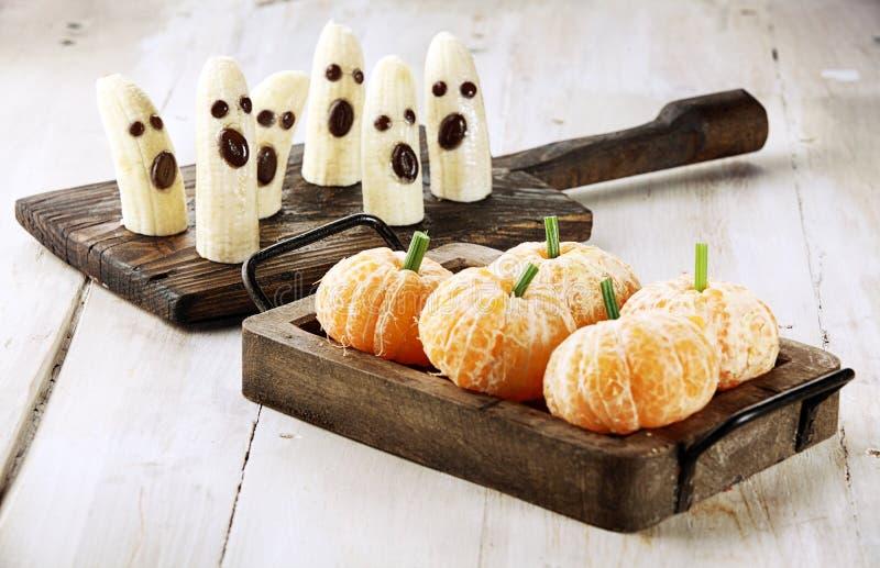 Invitaciones sanas de Halloween de la fruta imagenes de archivo