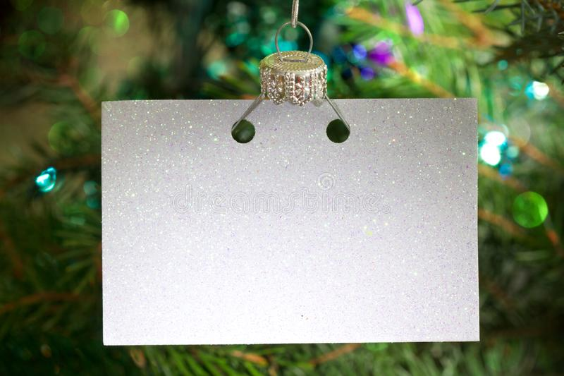 Invitation business empty card on the Christmas tree abstract background concept. Closeup stock images