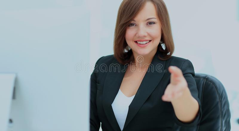 Happy smiling businesswoman in suit giving hand for handshake. Invitation concept. Elegant young business woman welcoming guests stock photos