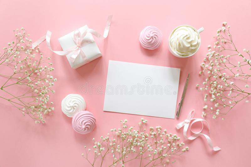 Invitation to a wedding or a greeting with the marriage, christenings in white pink colors with a space for text, flat lay. Horizontal. Top view royalty free stock photography