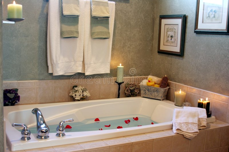 Inviting. A bathtub ready to be used royalty free stock photography