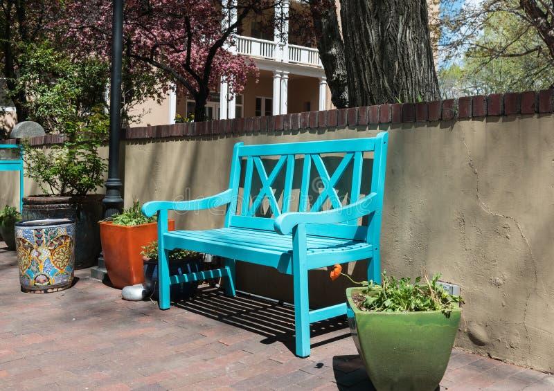 Inviting bench, Santa Fe, New Mexico. Blue bench and planters, Southwestern design in Santa Fe, New Mexico royalty free stock photos
