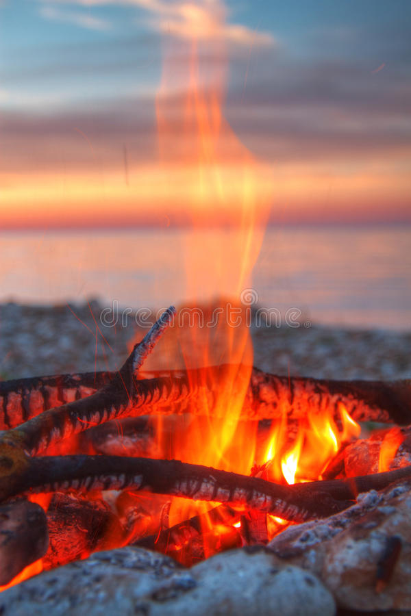 Inviting campfire on the beach royalty free stock photography